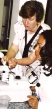 Dr. Fitzgerald works with a MIRT student in Dr. Toledo's lab in Brazil (2002)