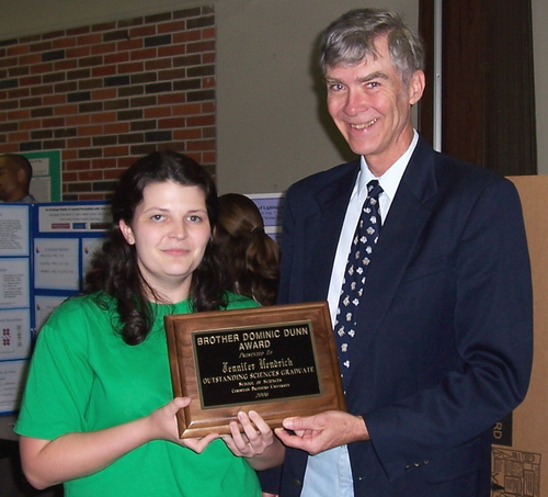 Dr. Holmes presents the 2006 Dominic Dunn Award to Jennifer Hendrick