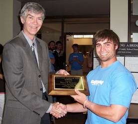 Dr. Holmes presents the 2007 Dominic Dunn Award to Bobby Lawrence