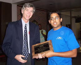 Dr. Holmes presents the 2005 Dominic Dunn Award to Manny Patel