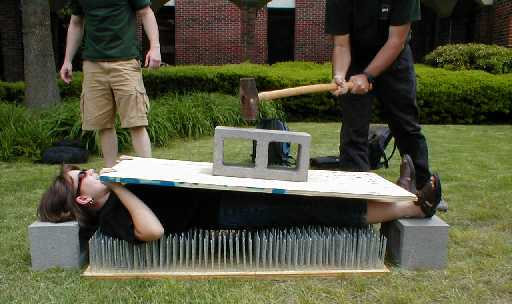 bed of nails with cinder block