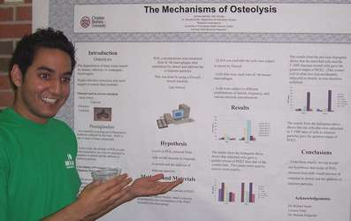 Andrew Michael, Biology alum 2006, with his senior research poster
