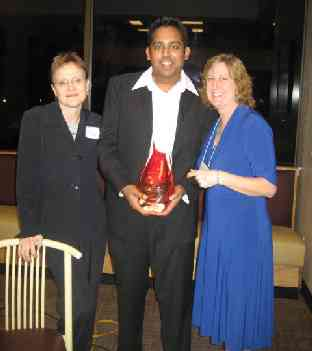 Manny Patel receiving his Distinguished Alumni award