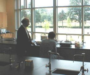 Dr. Merat with students in the Biochemistry Lab